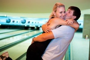 Pretty embracing couple in the bowling club.