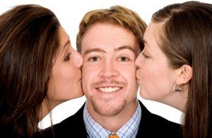 business man with two girls kissing him