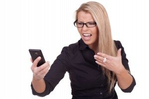 Frustrated woman looking at her mobile