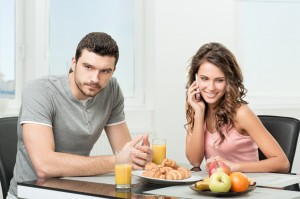 couple having breakfast, girl talking on the phone