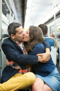 Couple kissing in the Parisian metro