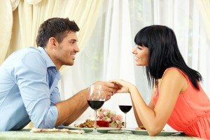 Beautiful couple having  romantic dinner at restaurant