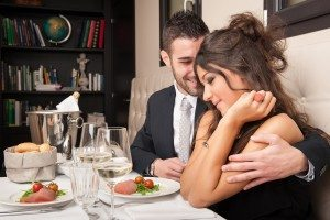 Attractive elegant young couple having dinner at the restaurant.