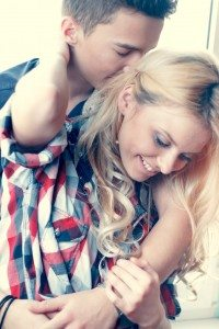 fashion portrait of young sensual couple. love and kiss