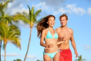 Couple having fun on beach vacation travel