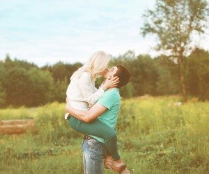 Sensual happy couple kissing outdoors