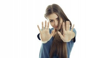 Woman making stop gesture with both her hands