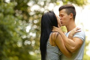 Kissing couple. Portrait of young caucasian couple kissing