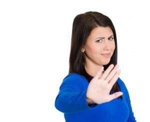 Annoyed young woman with bad attitude, giving talk to hand
