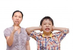 Young Asian Boy Being Scolded by his mother