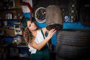 Female mechanic at work. auto service station