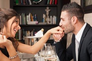 Attractive elegant young couple having romantic dinner at the re