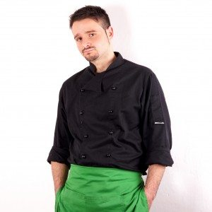 Studio shot of a young man with chef clothes