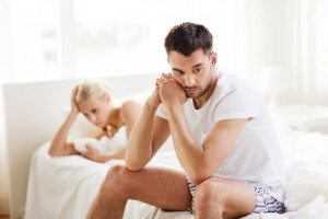 unhappy couple having problems at bedroom