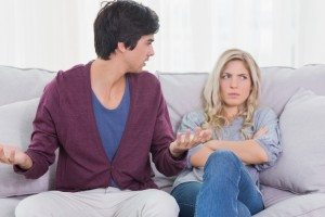 Young couple having an argument at home on the couch
