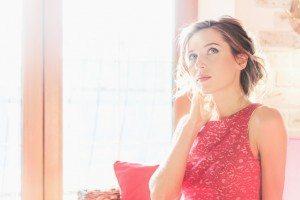 Beautiful brunette woman sitting near a sunny window