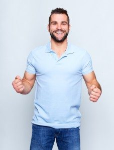 Happy young man in polo shirt