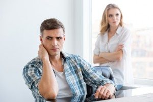 Upset man and woman having problems in relationships
